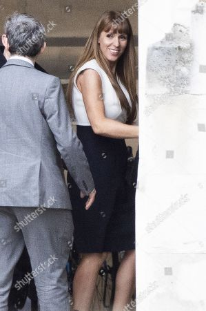 Labour Party Deputy leader contender Angela Rayner walks in The Houses of Parliament with colleagues.