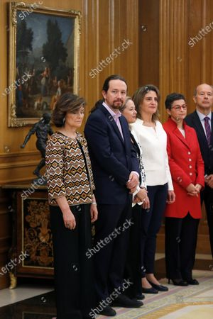 Deputy Prime Ministers of the new Government (L-R) Carmen Calvo, Pablo Iglesias, Nadia Calvino and Teresa Ribera are seen next to ministers of Foreign Affairs Arancha Gonzalez Laya and Justice Juan Carlos Campo Moreno during the new government's swearing-in ceremony held at Zarzuela Palace in Madrid, Spain, 13 January 2020.
