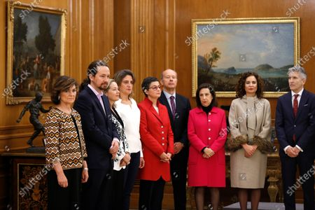 Deputy Prime Ministers of the new Government (L to R) Carmen Calvo, Pablo Iglesias, Nadia Calvino and Teresa Ribera are seen next to ministers of (from 5-L to R) Foreign Affairs Arancha Gonzalez Laya, Justice Juan Carlos Campor Moreno, Defense Margarita Robles, Treasure Maria Jesus Montero and Interior Fernando Grande-Marlaska during the swearing-in ceremony before King Felipe VI of Spain at Zarzuela Palace in Madrid, Spain, 13 January 2020. The partnership of PSOE socialists and leftist Unidas Podemos party members is the first coalition in Spain since 1975 when Spain became a democracy.