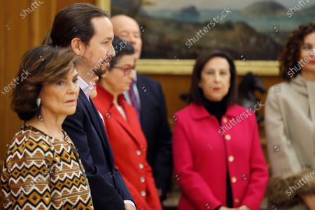 Deputy Prime Ministers of the new Government (L-R) Carmen Calvo and Pablo Iglesias are seen next to ministers of Foreign Affairs Arancha Gonzalez Laya Justice Juan Carlos Campo Moreno and Defense Margarita Robles during the new government's swearing-in ceremony held at Zarzuela Palace in Madrid, Spain, 13 January 2020. The partnership of PSOE socialists and leftist Unidas Podemos party members is the first coalition in Spain since 1975 when Spain became a democracy.