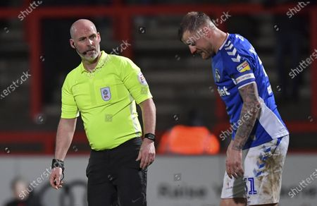 Kevin Johnson match referee checks David Wheater of Oldham Athletic is ok