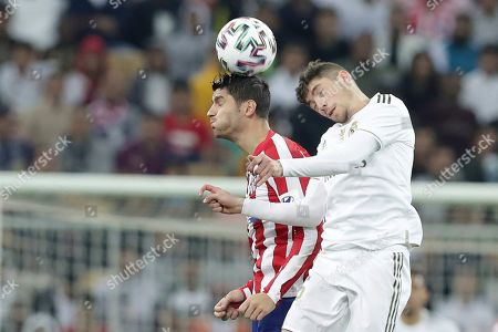 Stock Photo of Atletico Madrid's Alvaro Morata, left, heads the ball past Real Madrid's Federico Valverde during the Spanish Super Cup Final soccer match between Real Madrid and Atletico Madrid at King Abdullah stadium in Jiddah, Saudi Arabia