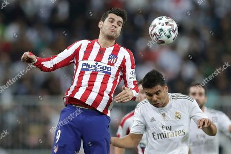 Stock Picture of Atletico Madrid's Alvaro Morata, left, jumps for the ball with Real Madrid's Casemiro during the Spanish Super Cup Final soccer match between Real Madrid and Atletico Madrid at King Abdullah stadium in Jiddah, Saudi Arabia