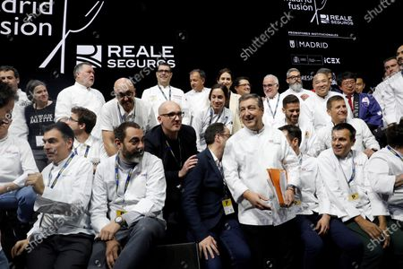Stock Picture of Madrid regional president, Isabel Diaz Ayuso (C, back row), poses with the participants of the event, including Spanish chef Joan Roca (C-L) during the 18th 'Madrid Fusion 2020' International Gastronomy Fair in Madrid, Spain, 13 January 2020. The gastronomic event, under the slogan 'Essential cuisine, thoughtful simplicity', runs from 13 to 15 January.