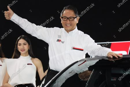 Toyota Motor president Akio Toyoda gives a thumb up as he unveils the GR Yaris, a homologation model for the FIA World Rally Championship (WRC) at a team presentation at the Tokyo Auto Salon 2020 in Chiba, suburban Tokyo on Friday, January 10, 2020. Some 1,000 vehicles will be exhibited at a three-day custom-car trade show.