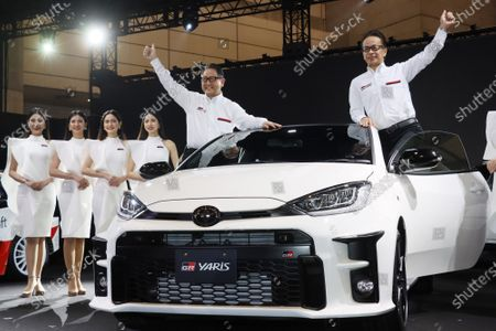 Toyota Motor president Akio Toyoda (L) and executive vice president Shigeki Tomoyama (R) give their thumb ups as they unveil the GR Yaris, a homologation model for the FIA World Rally Championship (WRC) at a team presentation at the Tokyo Auto Salon 2020 in Chiba, suburban Tokyo on Friday, January 10, 2020. Some 1,000 vehicles will be exhibited at a three-day custom-car trade show.