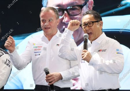 Toyota Motor president Akio Toyoda (R) and world rally team principal Tommi Makinen (L) of Finland raise their fists in the air at a team presentation at the Tokyo Auto Salon 2020 in Chiba, suburban Tokyo on Friday, January 10, 2020. Some 1,000 vehicles will be exhibited at a three-day custom-car trade show.