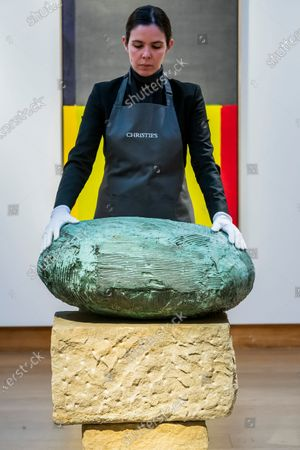 Stock Image of William Turnbull (1922-2012), Hero II, Estimate GBP 350,000 - GBP 450,000 in front of JOHN HAYLAND, R.A. (1934-2011) Estimate GBP 50,000 - GBP 80,000 (USD 65,750 - USD 105,200) signed and dated 'HOYLAND 8.5.68. Painted in 1968 and other works