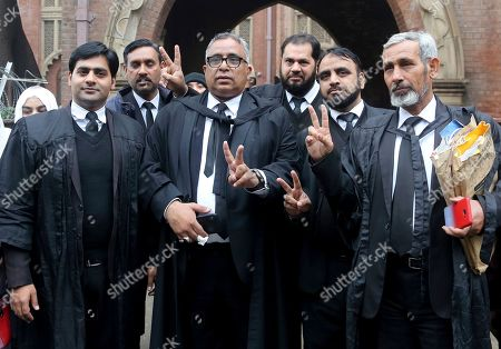 Stock Image of Mohammad Azhar Siddique, center, a lawyer for former Pakistani President and military ruler Pervez Musharraf, and other lawyers make a victory sign after a court decision, in Lahore, Pakistan, . The Pakistani court Monday overturned a death sentence given to the country's ailing former dictator, saying a special court that last month convicted and sentenced Musharraf had been formed in violation of the law