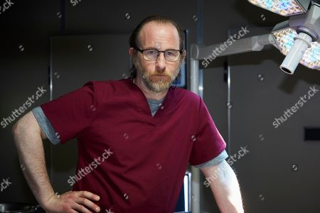 Stock Picture of Paul Kaye as Malcolm Donahue.