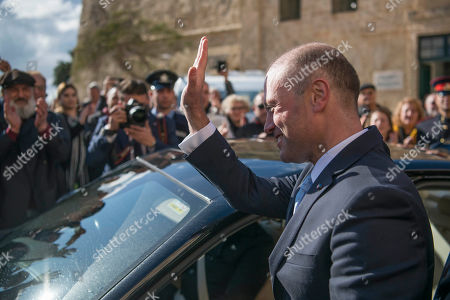 Joseph Muscat leaves his office of Castille for the last time, as he goes to the president with his resignation, in Valletta, Malta, . Robert Abela is replacing Muscat as premier after weeks of protests demanding accountability in the investigation of the car bomb slaying of an anti-corruption journalist who targeted his government