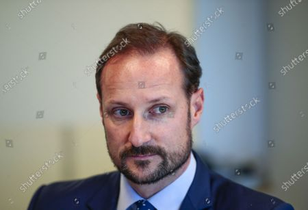 Norway's Crown Prince Haakon looks on during a visit to the Norwegian Refugee Council's headquarters in Oslo, Norway, 13 January 2020 where he was shown a Virtual Reality (VR) presentation of a refugee camp. A total of 2,304 people applied for asylum in Norway in 2019 with the biggest group coming from the Syrian Arab Republic with 537 applications, followed by Turkey (360 applications) and Eritrea (194 applications), according to the website of the Norwegian Directorate of Immigration UDI.
