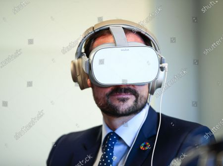 Norway's Crown Prince Haakon wears a Virtual Reality (VR) device as he visits the Norwegian Refugee Council's headquarters in Oslo, Norway, 13 January 2020. The Crown Prince was shown a VR presentation of a refugee camp. A total of 2,304 people applied for asylum in Norway in 2019 with the biggest group coming from the Syrian Arab Republic with 537 applications, followed by Turkey (360 applications) and Eritrea (194 applications), according to the website of the Norwegian Directorate of Immigration UDI.