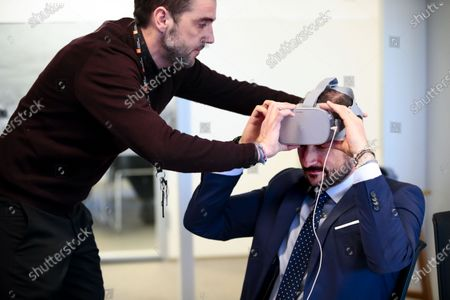 Norway's Crown Prince Haakon is helped to put on a Virtual Reality (VR) device as he visits the Norwegian Refugee Council's headquarters in Oslo, Norway, 13 January 2020. The Crown Prince was shown a VR presentation of a refugee camp. A total of 2,304 people applied for asylum in Norway in 2019 with the biggest group coming from the Syrian Arab Republic with 537 applications, followed by Turkey (360 applications) and Eritrea (194 applications), according to the website of the Norwegian Directorate of Immigration UDI.