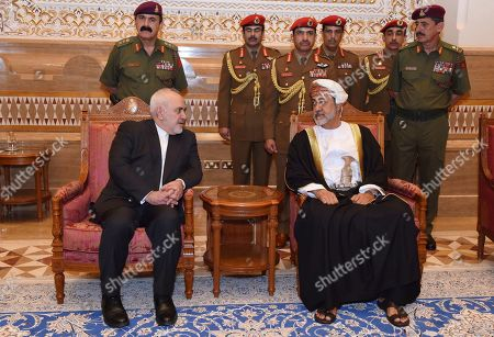 """Made available by the Oman News Agency, Oman's new Sultan Haitham bin Tariq Al Said, right, receives Iranian Foreign Minister Javad Zarif, after his arrival to attend an official mourning ceremony for the late Sultan Qaboos, in Muscat, Oman. A flurry of diplomatic visits and meetings crisscrossing the Persian Gulf are driving urgent efforts to defuse the possibility of all-out war after the U.S. killed Iran's top military commander. Global leaders and top diplomats are repeating in recent days the mantra of """"de-escalation"""" and """"dialogue,"""" yet none have publicly laid out a path to achieving either"""