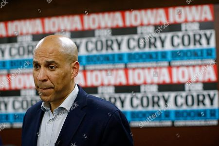 Democratic presidential candidate Sen. Cory Booker, D-N.J., speaks with attendees after a campaign event in Mount Vernon, Iowa. Booker has dropped out of the presidential race after failing to qualify for the December primary debate