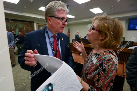 Lorie Haas, Brain Moran. Sec. of Public Safety, Brian Moran, left, talks with Lorie Haas, during the meeting of the Senate Judiciary committee at the Capitol in Richmond, Va., . The committee passed several gun related bills