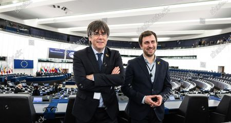Former members of the Catalan government Toni Comin (R) and Carles Puigdemont (L) wait for their  first plenary session as member of the European Parliament in Strasbourg, France, 13 January 2020.