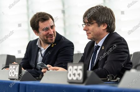 Former members of the Catalan government Toni Comin (L) and Carles Puigdemont (R) wait for their  first plenary session as member of the European Parliament in Strasbourg, France, 13 January 2020.