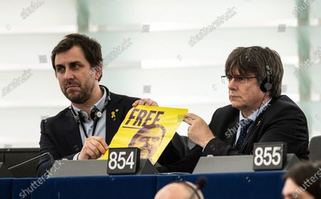 Former members of the Catalan government Toni Comin (L) and Carles Puigdemont (R) attend their  first plenary session as member of the European Parliament in Strasbourg, France, 13 January 2020 and hold a poster with jailed Catalan politician Oriol Junqueras.