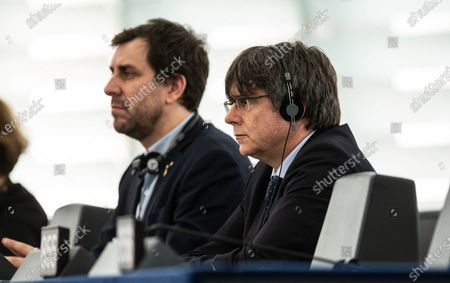 Former members of the Catalan government Toni Comin (L) and Carles Puigdemont (R) attend their  first plenary session as member of the European Parliament in Strasbourg, France, 13 January 2020.