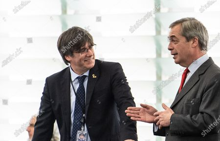 Former member of the Catalan government Carles Puigdemont (L)  speaks with Nigel Farage of the Brexit Party (R)  before his  first plenary session as member of the European Parliament in Strasbourg, France, 13 January 2020.