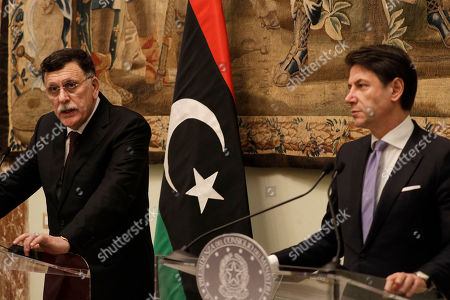 Fayez al-Sarraj, Giuseppe Conte. Libya's Prime Minister Fayez al-Sarraj, left, holds a joint press conference with Italian Premier Giuseppe Conte after their meeting at Chigi palace, in Rome. Russia is convening Libya's rival leaders for peace talks on Monday, Jan. 13, 2020, a diplomatic push closely coordinated with Turkey. Russia and Turkey, accused of exacerbating the fighting by backing dueling sides, have emerged as major players in Libya's war, outmaneuvering European powers that pressed for peace as the fighting in the strategic, oil-rich country only accelerated
