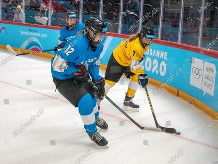 Stock Picture of Nikki Sharp (blue) and Iris van Houten (yellow) are seen in action during the women's mixed NOC 3-on-3 ice hockey preliminary round (game 20; blue v yellow) on Day 3