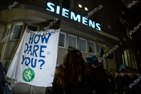 Fridays For Future activists holding a placard reading 'How dare you?' protest in front of the Siemens AG gas turbine plant in Berlin, Germany, 13 January 2020. The environmental activists spontaneously meet to demonstrate against the decision made by Siemens CEO Joe Kaeser to continue participating in the Adani coal project.