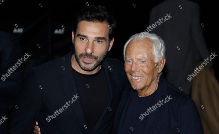 Italian fashion designer Giorgio Armani, right, poses with Italian actor Edoardo Leo after the Armani men's Fall-Winter 2020/21 fashion show, that was presented in Milan, Italy