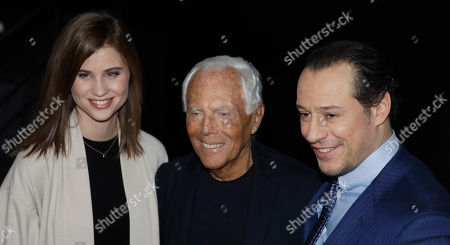 Stock Picture of Italian fashion designer Giorgio Armani poses with Italian actor Stefano Accorsi and model Bianca Vitali pose after the Armani men's Fall-Winter 2020/21 fashion show, Fall-Winter 2020/21 collection, that was presented in Milan, Italy