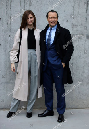 Stock Image of Italian actor Stefano Accorsi is flanked by his wife and model Bianca Vitali arrive for the Armani men's Fall-Winter 2020/21 collection, that was presented in Milan, Italy