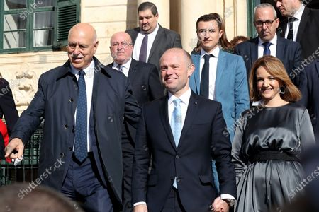 Stock Image of Malta's Outgoing Malta Prime Minister Joseph Muscat (C) and his wife Michelle (R) leave the Auberge De Castille to pave way for the newly elected Partit Laburista (Labour Party) leader and new Prime Minister Robert Abela (not in picture) in Valletta, Malta, 13 January 2020.