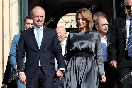 Malta's Outgoing Malta Prime Minister Joseph Muscat (L) and his wife Michelle leave the Auberge De Castille to pave way for the newly elected Partit Laburista (Labour Party) leader and new Prime Minister Robert Abela (not in picture) in Valletta, Malta, 13 January 2020.