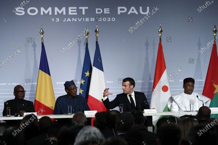 French President Emmanuel Macron (2-R) flanked by Mali's President Ibrahim Boubacar Keita (2-L), Niger President Mahamadou Issoufou (R), and Chad's President Idriss Deby (2-L) speaks during a press conference as part of the G5 Sahel summit on the situation in the Sahel region at the Chateau de Pau in Pau, France, 13 January 2020.