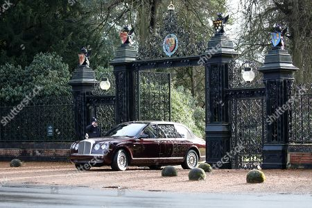 Queen Elizabeth II is driven through the Norwich Gates, at Sandringham House, as she attends the St. Mary Magdalene Church Sunday morning service