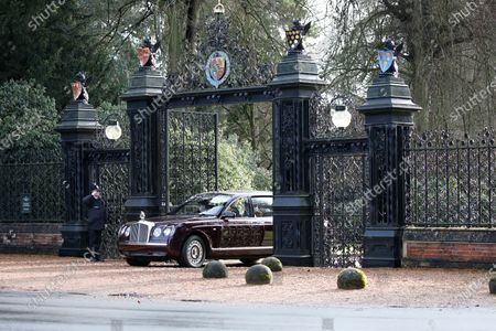 Queen Elizabeth II is driven through the Norwich Gates, at Sandringham House, as she attends the St. Mary Magdalene Church Sunday morning service in Sandringham