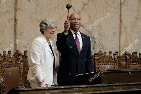 New House Speaker Laurie Jinkins, D-Tacoma, left, looks on as Speaker Pro Tem John Lovick, D-Mill Creek, gives her some pointers on banging the gavel as they pose for photos, on the first day of the 2020 session of the Washington legislature at the Capitol in Olympia, Wash