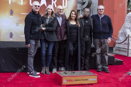 Sir Patrick Stewart (3-L) poses next to American-British actress Marina Sirtis (3-R), US actor Levar Burton (2-R), US actor Brent Spiner (L), US actress Gates McFadden (2-L) and US TV producer Rick Berman (R) during his hands and footprints ceremony at the Chinese Theater in Hollywood, California, USA, 13 January 2020.