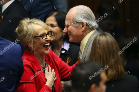Stock Picture of Former Arizona Republican Gov. Jan Brewer, left, laughs with Arizona Corporation Commission member Bob Burns, right, prior to Arizona Republican Gov. Doug Ducey's State of the State address on the opening day of the legislative session at the Capitol, in Phoenix