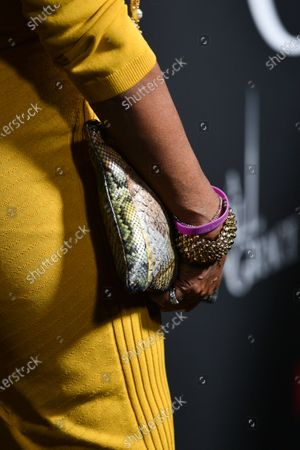 Gayle King, bag and bracelet detail