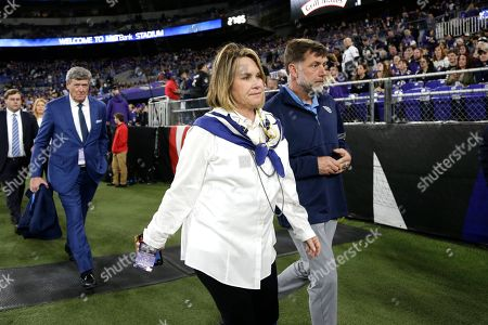 Tennessee Titans controlling owner Amy Adams Strunk walks on the turf prior to an NFL divisional playoff football game against the Baltimore Ravens, in Baltimore. The Titans won 28-12