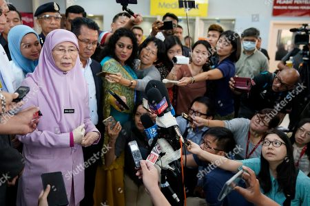 Malaysian Deputy Prime Minister Wan Azizah Ismail, left, speaks to media after she visited Japanese badminton player Kento Momota who was lightly injured during a car accident in Malaysia early Monday at hospital in Putrajaya, Malaysia