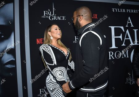 """Mariah Carey, Tyler Perry. Singer Mariah Carey, left, and filmmaker Tyler Perry greet each other at the premiere of Tyler Perry's """"A Fall from Grace"""" at Metrograph, in New York"""