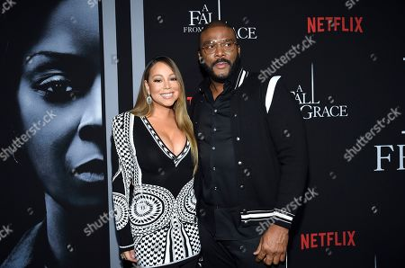 """Mariah Carey, Tyler Perry. Singer Mariah Carey, left, and filmmaker Tyler Perry pose together at the premiere of Tyler Perry's """"A Fall from Grace"""" at Metrograph, in New York"""