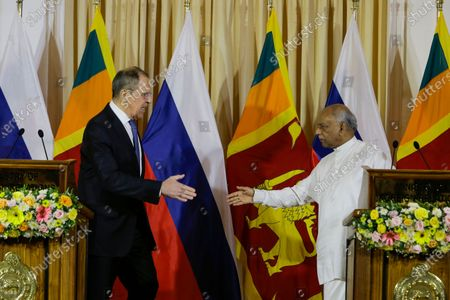Russian Foreign Minister Sergei Lavrov (L) and Sri Lanka's Foreign Minister Dinesh Gunawardena (R) shake hands at the end of a joint press conference following their meeting at the Ministry of Foreign Affairs in Colombo, Sri Lanka, 14 January 2020. Lavrov is in Sri Lanka on a two-day official visit.