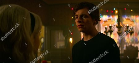 Kiernan Shipka as Sabrina Spellman and Ross Lynch as Harvey Kinkle