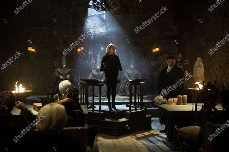 Stock Picture of Keirnan Shipka as Sabrina Spellman and Richard Coyle as Father Faustus Blackwood