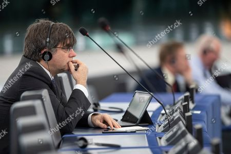 Stock Photo of Catalonia's former regional president Carles Puigdemont listens to speeches at the European parliament Tuesday, Jan.14, 2020 in Strasbourg, eastern France. Croatian Prime Minister Andrej Plenkovic will present the priorities of the rotating Council presidency for the next six months