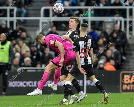 14th January 2020, St. James's Park, Newcastle, England; Emirates FA Cup, Newcastle United v Rochdale : Emil Krafth (17) of Newcastle United in an aerial challenge with Aaron Wilbraham (18) of Rochdale